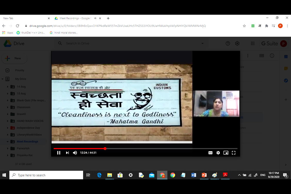 Teacher playing video and sharing information related to Gandhi Ji